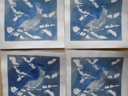 Linoryt kolorowy - ptak na gałązce okrytej śniegiem